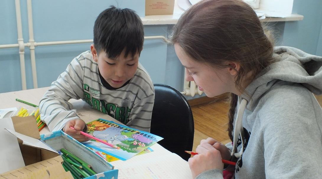 An intern works on a colouring activity during her Social Work internship in Mongolia
